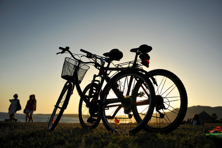 southern europe: bikes on the beach of Bolonia at sunset, Tarifa, Spain, Southern Europe Stock Photo