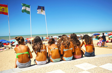 Group of young girls on the beach of Chipiona, summer vacation, Costa de la luz, Cadiz province, Spain