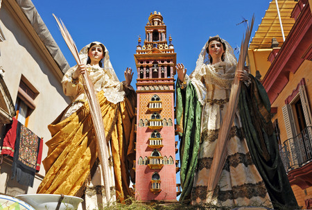 Saint Justa and Saint Rufina with the Giralda, Corpus Christi in Triana, religious procession in Seville, Andalusia, Spain Stock Photo