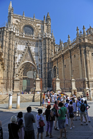 Group of tourists waiting to get into the Cathedral of Seville, Andalusia, Spain