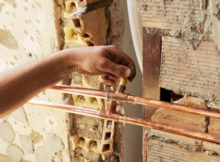 splice: Plumber installing a splice in the copper pipes