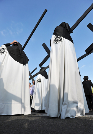 Holy Week in Seville (Semana Santa), Nazarenes with crosses of penance, Andalusia, Spain