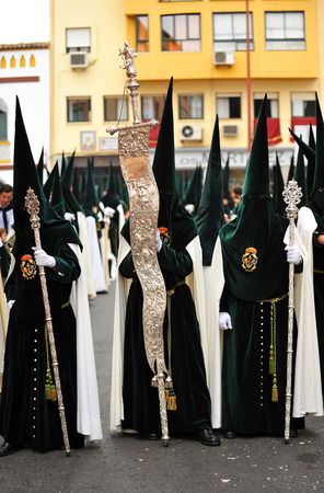 holy week in seville: Nazarenes, Holy Week in Seville, brotherhood of hope, Andalusia, Spain