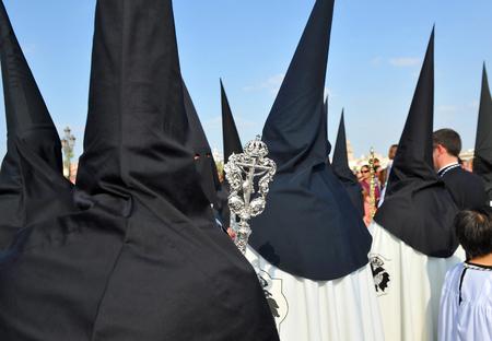 semana: Holy Week in Seville (Semana Santa), brotherhood of Nazarenes in the Triana district, Andalusia, Spain Stock Photo
