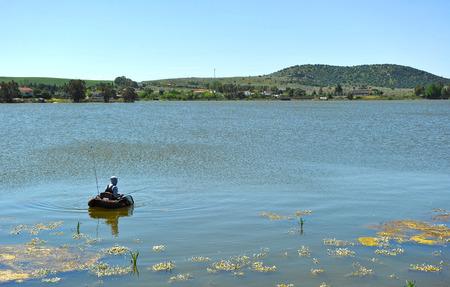 steelyard: Fisherman fishing in the Roman dam of Proserpina, M�rida, Badajoz, Spain