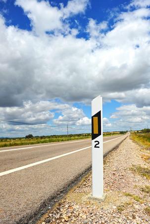 road shoulder: National road, marker on the hard shoulder, Spain Stock Photo