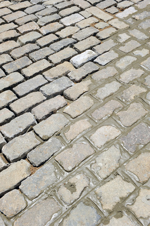 public works: Paving a street with cobblestones