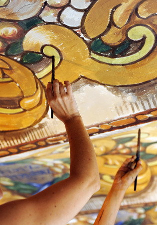 restoring: restoring ancient mural paintings on the ceiling