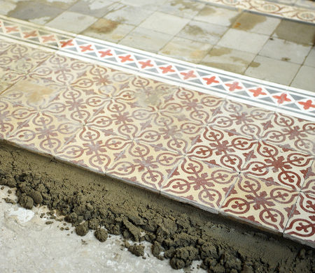Placing a cement floor tiles, vintage decoration Stock Photo