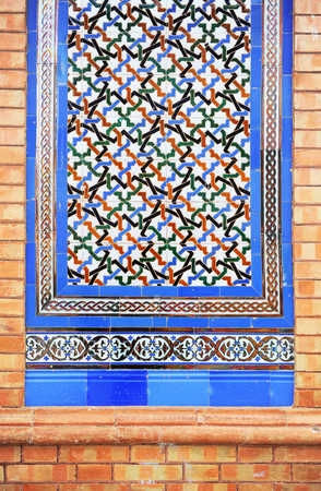 plinth: closeup of a tile plinth in moorish style on the facade of a mansion