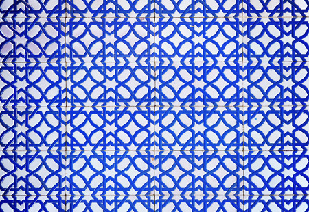 plinth: closeup of a tile plinth in moorish style in white and blue color