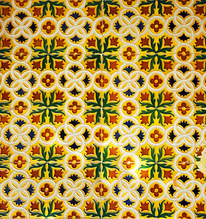 spanish houses: mosaic tiles (azulejos) of relief type, background decorative used in rooms of the Spanish houses Stock Photo