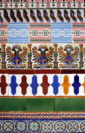 composition of polychrome tiles (azulejos) of various designs reused, vintage decorative detail, Cartuja, Seville, Spain