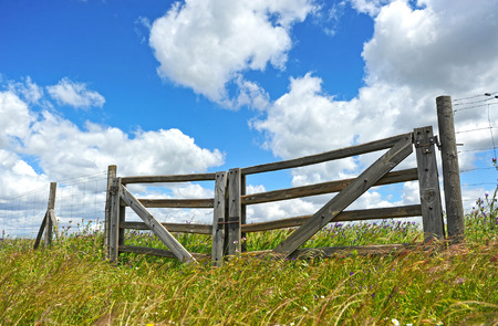 stakes: Wooden gate in the countryside Stock Photo