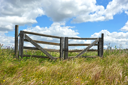 Wooden gate in the countryside Stock Photo