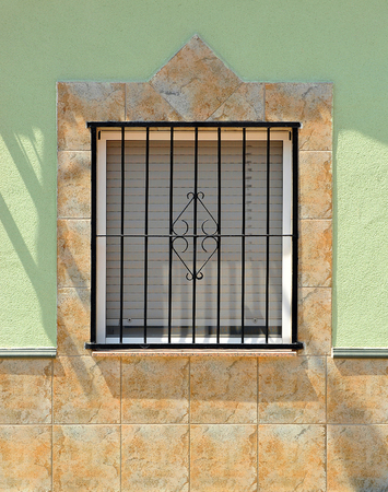 naif: popular architecture, original window in a village in southern Spain