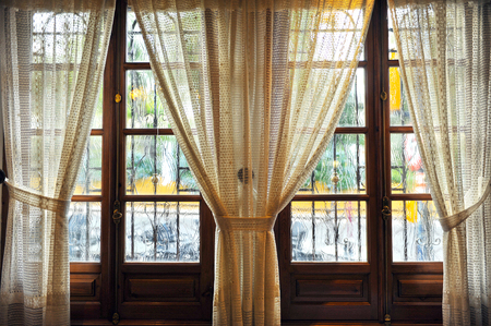 naif: cozy interior, window with curtains