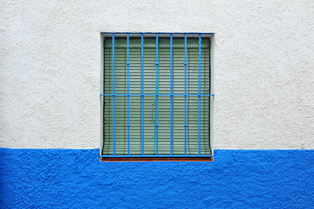 naif: popular architecture, simple window in a village in southern Spain