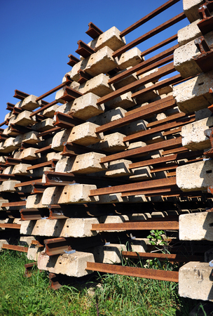 locomotion: Warehouse of obsolete railway equipment, Concrete sleepers stacked outdoors