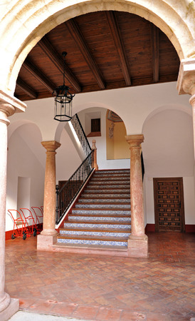 edification: staircase of monastery of San Zoilo, current home of the Public Library in Antequera, Malaga province, Spain