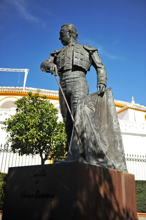tribute: Sculpture tribute to Curro Romero, famous Spanish bullfighter in front of the bullring of the Maestranza, Seville, Spain Editorial