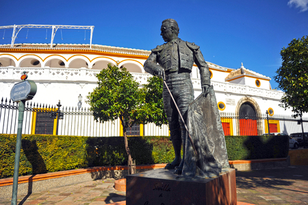 Sculpture tribute to Curro Romero, famous Spanish bullfighter in front of the bullring of the Maestranza, Seville, Spain Editorial