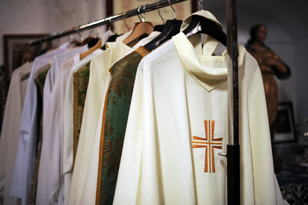 liturgical: The sacristy of a catholic church, chasubles for priests Stock Photo