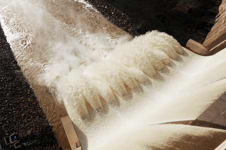 open floodgates of a dam after the autumn rains and winter, reservoir of Montoro, Ciudad Real, Spain Stock Photo