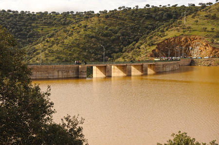 rains: Full reservoir after the autumn and winter rains, dam of Montoro, Ciudad Real province, Spain Stock Photo
