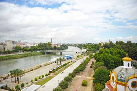 panoramic view of the Guadalquivir river with the bridges in the background, Seville, Andalusia, Spain