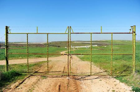 Entrance gate, Cereal crop farm in the region of Tierra de Barros, province of badajoz, Extremadura, Spain
