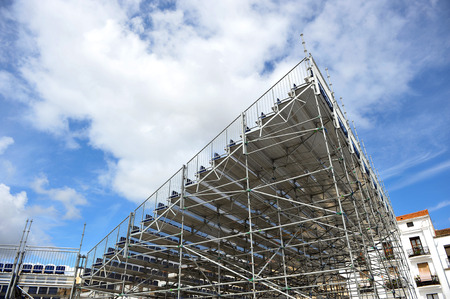 aluminum structure with extra bleachers and seats for a outdoor show