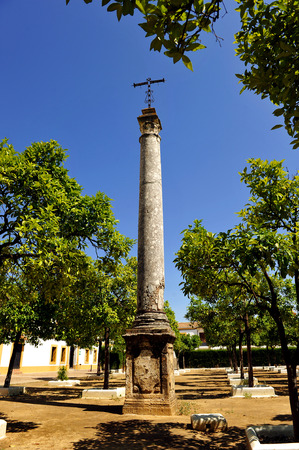 column with cross in the Monastery of San Isidoro del Campo in Santiponce, province of Sevilla, Andalusia, Spain