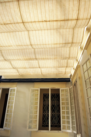 awnings: yard of a house covered with canvas awnings for the sun heat during the summer in Andalusia, Spain Stock Photo