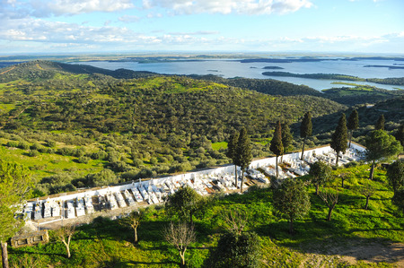 southern europe: in the foreground the cemetery of village Monsaraz and in the background  the Alqueva dam, Alentejo, Portugal, southern Europe