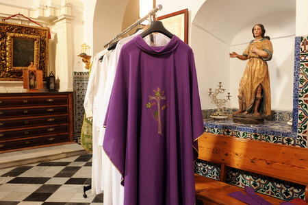 Chasubles for priests on the inside of the sacristy of a Catholic church Editorial