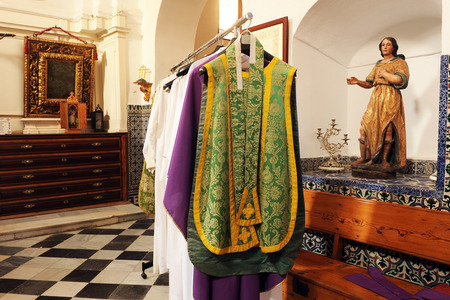 Inside the sacristy of a church, chasubles for priests