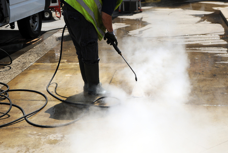 steam jet: Cleaner of the pavement of the street with pressurized water