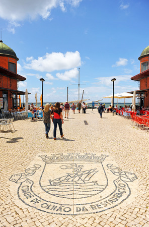 stoned: famous main market square with the shield of the city on the stone pavement, Olhao, Algarve region, Portugal, southern Europe