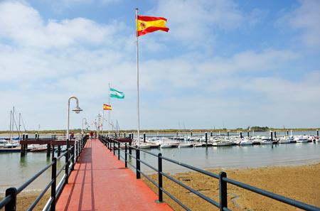 Pier à El Rompido, province de Huelva, Andalousie, Espagne Banque d'images