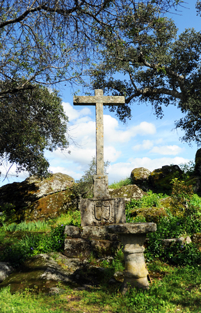 singular architecture: Stone cross in the Monastery of Palancar, Pedroso de Acim, province of Caceres, Spain Stock Photo