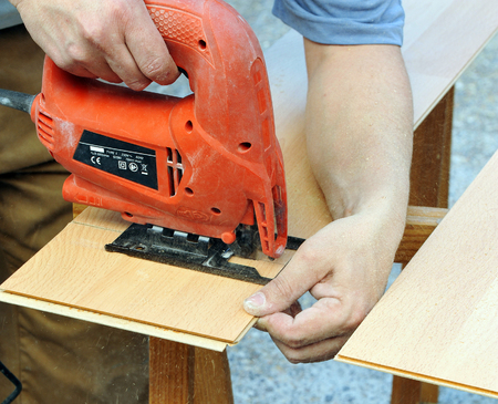 cut off saw: Carpenter working with an electric saw