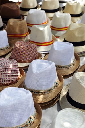 Flea market in Spain, spanish straw hats for summer