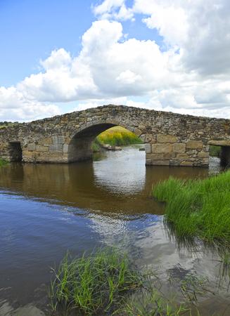 Medieval bridge of Santiago de Bencaliz, Caceres province, Spain Stock Photo