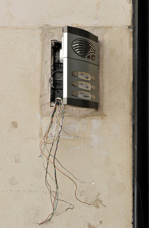 interphone: Installation of the new intercom on the building door Stock Photo