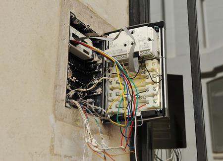 interphone: Placing the new intercom phone on the building door Stock Photo