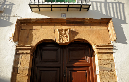 Coat of arms on the door of a house, Almagro, province of Ciudad Real, Castilla la Mancha, Spain