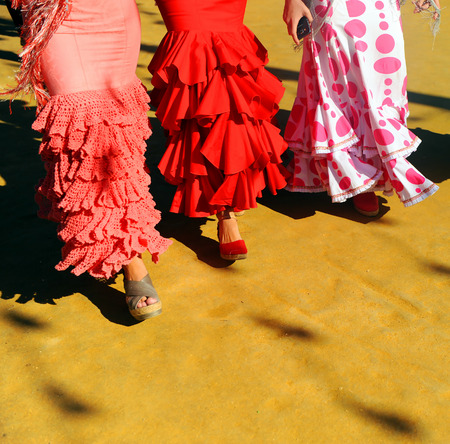 Andalusian women walking at the Fair in Seville, Spain Stock Photo