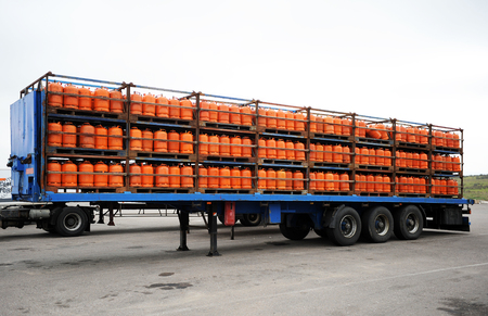 butane: Trailer of a truck loaded with butane gas cylinders Stock Photo