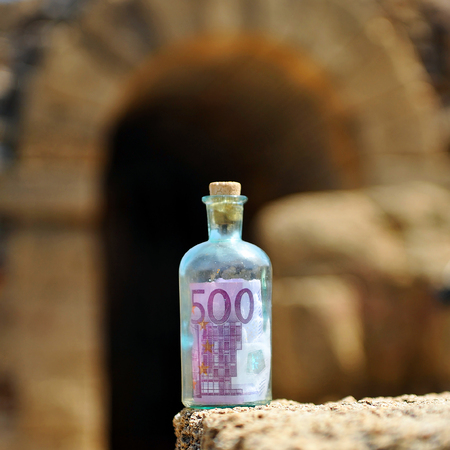 international crisis: Old bottle with five hundred euros, power of money
